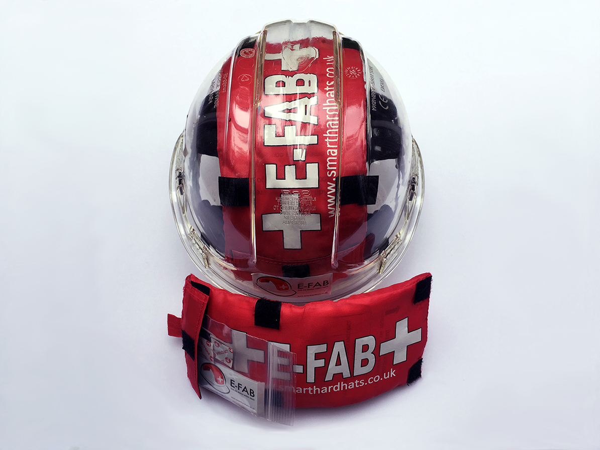 Photo of the E-FAB installed in a clear hard hat, beside an uninstalled E-FAB pack